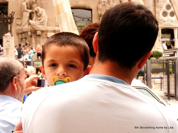 Boy and his father at the Sagrada familia cathedral