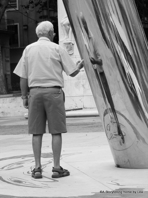 Man playing with a Dali themed installation, Figueras