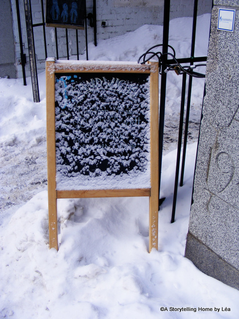 Outdoor sign covered in snow