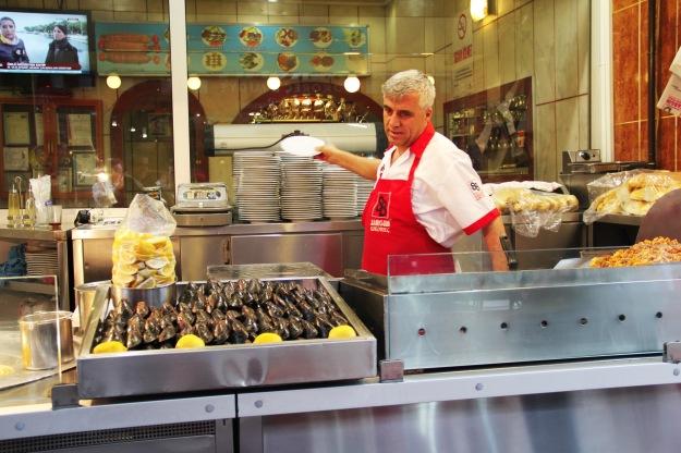 Serving midye dolma (stuffed mussels)